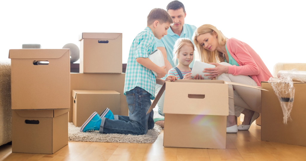 movingtips for family unpacking boxes after arduous move